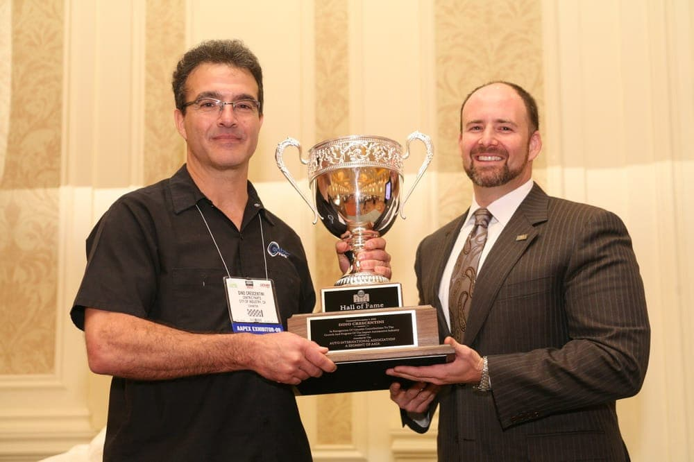 Centric Parts CEO Dino Crescentini (left) was entered into the AIA Aftermarket Hall of Fame during AAPEX 2009