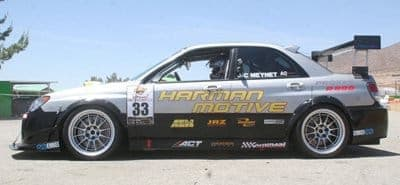 The Harmon Motive Subaru STi set the Time Attack pision and class record at Willow Springs with StopTech's new track-only Trophy Brake System