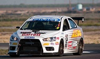 Stephen Ruiz, the newest edition to Team StopTech, pilots the StopTech Mitsubishi Evo X to victory at the 2010 Time Attach season opener at Buttonwillow