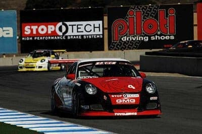 Dino-in-front-of-ST-billboard-at-Laguna-Seca-2009